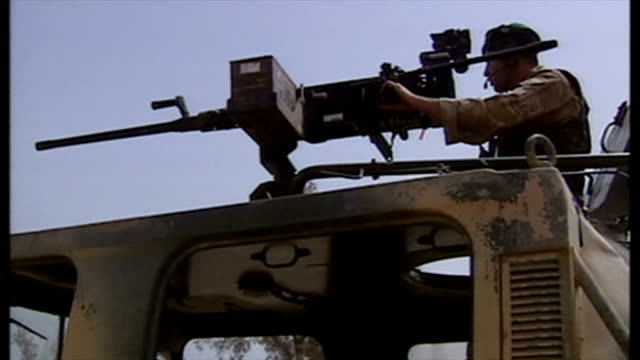 exterior shots british soldiers at road checkpoint with warthog military vehicle and soldier manning mounted machine gun at the start of the 2003... - british military stock videos and b-roll footage