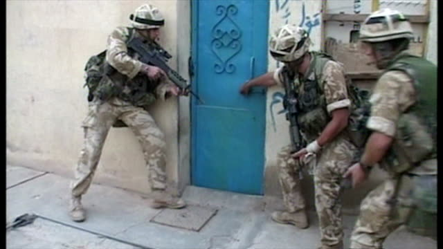 exterior shots british soldiers on patrol in umm qasr entering and searching houses, at the start of the 2003 invasion of iraq. on march 26, 2003 in... - iraq stock videos & royalty-free footage