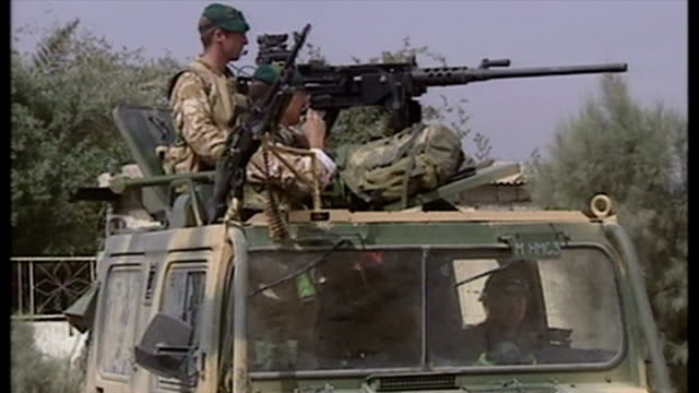 exterior shots british soldiers on patrol with warthog military vehicle and soldier manning mounted machine gun on top of vehicle at the start of the... - british military stock videos and b-roll footage