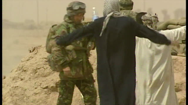 exterior shots british soldiers searching iraqi men at the side of the road looking for weapons, at the start of the 2003 invasion of iraq. on march... - iraq stock videos & royalty-free footage