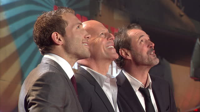 exterior shots bruce willis jai courtney sebastian koch posing for press on red carpet a good day to die hard film premiere at leicester square on... - bruce willis stock videos and b-roll footage