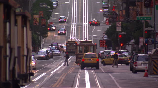exterior shots busy city streets with trams traffic on hilly roads san francisco hilly streets traffic on october 31 2010 in san francisco california - san francisco california stock videos & royalty-free footage