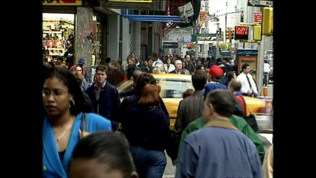 exterior shots busy times square streetscenes with tourists and commuters walking along street and crossing road and man using street pay phone on... - pay phone stock videos and b-roll footage