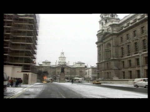 exterior shots camera crews running from explosion at back of downing street, policeman directing people away. exterior shots smoke rising from rear... - bomb stock videos & royalty-free footage