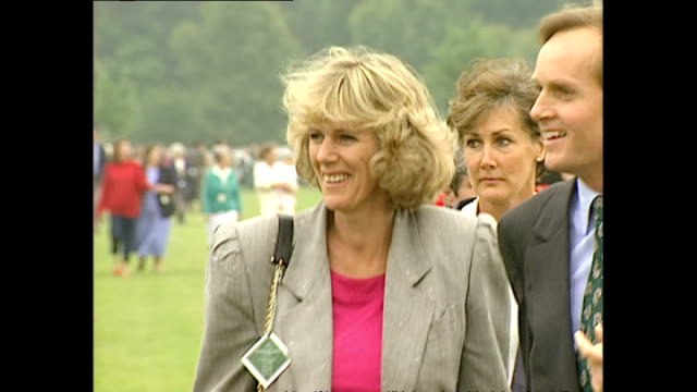 Exterior shots Camilla Parker Bowles walk into enclosure past camera