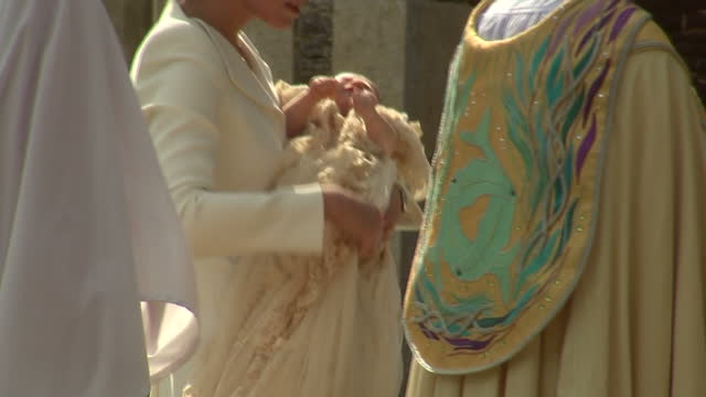 exterior shots catherine, duchess of cambridge carrying princess charlotte of cambridge into church of st mary magdalene in for christening. on july... - 2015 stock videos & royalty-free footage
