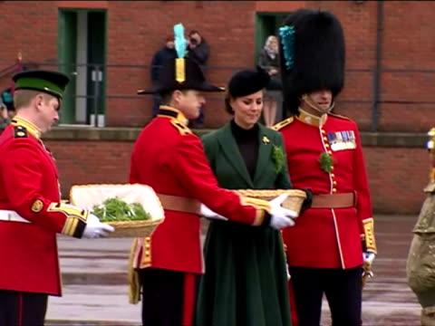 vidéos et rushes de exterior shots catherine duchess of cambridge presents sprigs of shamrocks duke duchess of cambridge visit the 1st battalion irish guards at the st... - mons barracks