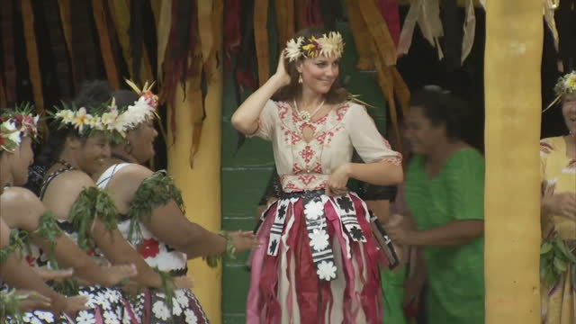 exterior shots catherine duchess of cambridge puts on traditional skirt joins in with local women dancing as six island communities celebrate... - 2012 stock videos & royalty-free footage