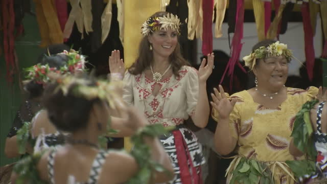 exterior shots catherine, duchess of cambridge wearing garland in her hair & traditional skirt dances & shimmies along with local woman during... - skirt stock videos & royalty-free footage
