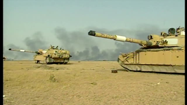 exterior shots challenger 2 tanks positioned around royal scots dragoon guards camp at the start of the 2003 invasion of iraq on march 29 2003 in... - iraq war stock videos and b-roll footage
