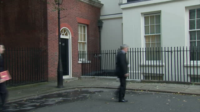 exterior shots chancellor george osborne arrives at number 11 downing street & briefly poses for the press george osborne arrives at number 11 at... - george osborne stock videos & royalty-free footage