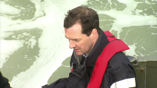 exterior shots chancellor george osborne arrives by speedboat to visit royal navy's submarine base at faslane on august 31 2015 in faslane scotland - チャンセラー点の映像素材/bロール
