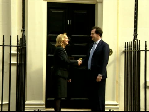 exterior shots chancellor george osborne austrian finance minister maria fekter pose for photo call outside number 11 downing street george osborne... - austrian culture stock videos and b-roll footage