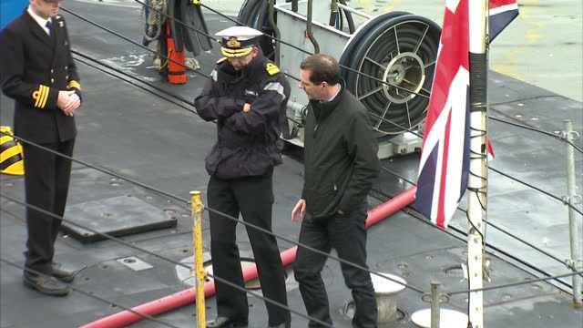 exterior shots chancellor george osborne being shown around top of submarine during visit two the royal navy's submarine base at faslane on august 31... - チャンセラー点の映像素材/bロール