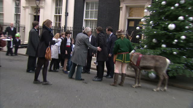exterior shots chancellor george osborne & doctor who actor matt smith pose with children & a pair of reindeer in front of the christmas tree in... - doctor who stock videos & royalty-free footage