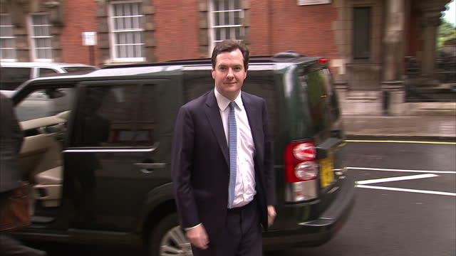 exterior shots chancellor george osborne leaves car walks into millbank george osborne arrives at millbank on july 03 2012 in london england - george osborne stock videos & royalty-free footage