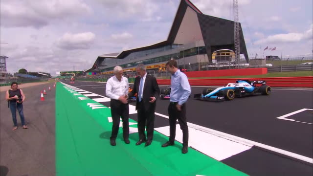 exterior shots chase carey, chairman, formula 1, stuart pringle, silverstone managing director, john grant, silverstone circuit owner on 10th... - silverstone stock videos & royalty-free footage