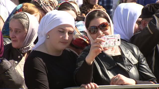exterior shots chechen people chechens at peace day of chechen republic concert people listening to music women taking selfie photo at concert on... - grosny stock-videos und b-roll-filmmaterial