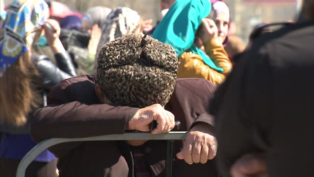 exterior shots chechen people chechens at peace day of chechen republic concert people listening to music on april 16 2015 in grozny russia - grosny stock-videos und b-roll-filmmaterial