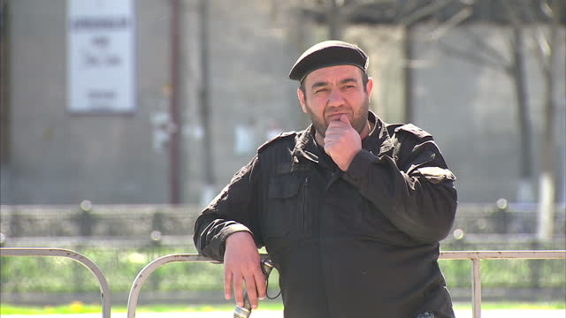 exterior shots chechen people chechens at peace day of chechen republic concert people listening to music security guard at concert on april 16 2015... - grosny stock-videos und b-roll-filmmaterial