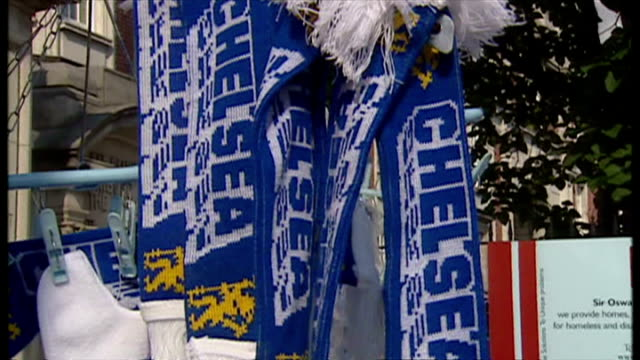 exterior shots chelsea fc fans outside stamford bridge stadium on match day with street vendors selling chelsea fc merchandise on august 23 2002 in... - スタンフォードブリッジ点の映像素材/bロール
