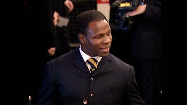 exterior shots chris eubank, british boxer, with his wife on the red carpet for the premiere of goldeneye, the seventeenth james bond film, at the... - chris eubank sr stock videos & royalty-free footage