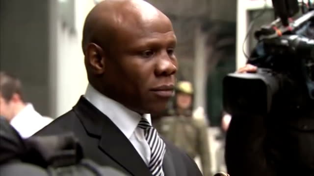 exterior shots chris eubank walk from high court to face press chris eubank court departure on march 18, 2013 in london, england - chris eubank sr stock videos & royalty-free footage