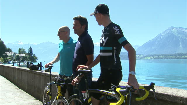 exterior shots chris froome posing for photo op by thunersee lake with fausto pinarello and sir dave brailsford with team sky pinarello bike on july... - lake thun stock videos and b-roll footage
