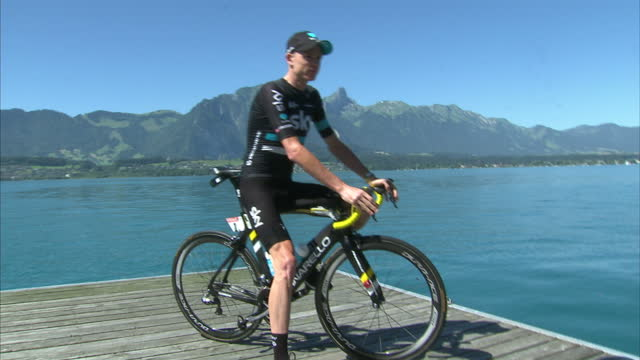 exterior shots chris froome posing for photo op by thunersee lake with team sky pinarello bike on july 19 2016 in thun switzerland - lake thun stock videos and b-roll footage
