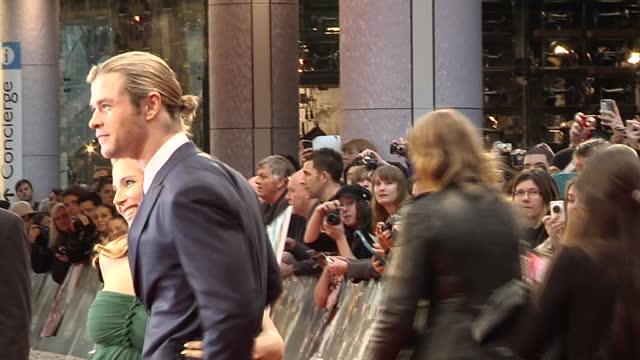 Exterior shots Chris Hemsworth walks on the red carpet at the Marvel Avengers premier poses for the media with his wife Elsa Pataky Chris Hemsworth...