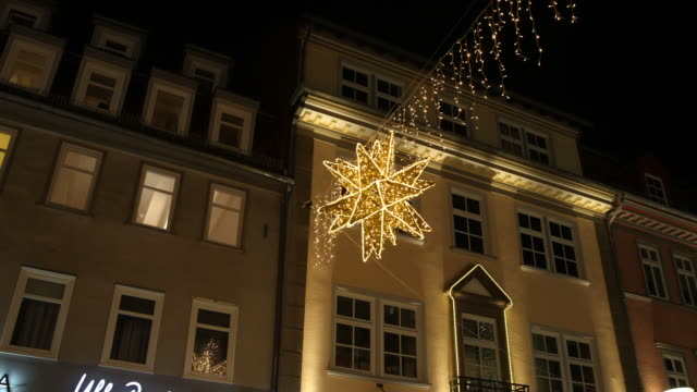 exterior shots christmas decoration illuminated in front of buildings downtown in göttingen in germany - advent calendar stock videos & royalty-free footage