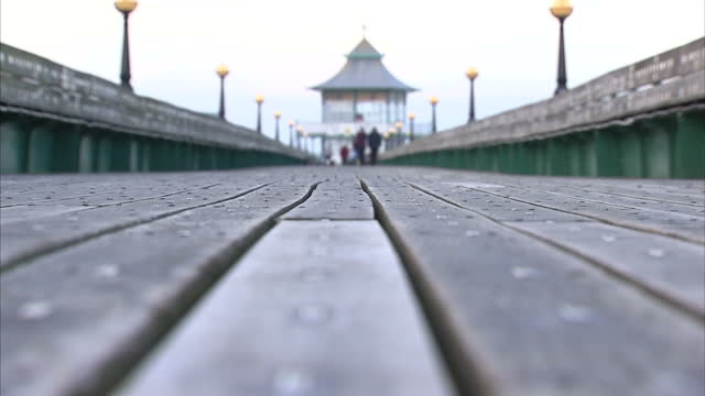 exterior shots clevedon pier with people walking around and fishing from pier. on december 20, 2016 in clevedon, united kingdom. - clevedon pier stock videos & royalty-free footage