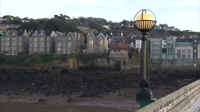 exterior shots clevedon pier with people walking around and man fishing from pier. on december 20, 2016 in clevedon, united kingdom. - clevedon pier stock videos & royalty-free footage