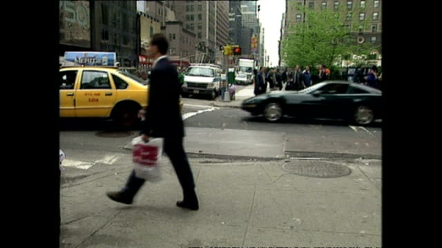 stockvideo's en b-roll-footage met exterior shots commuters and tourists walking along street past bags of rubbish at side of the road on september 01 1999 in new york city - 1990 1999