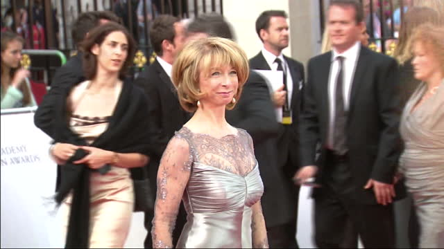 exterior shots coronation street actress helen worth poses for the press on the red carpet bafta television awards red carpet arrivals on may 22 2011... - コロネーションストリート点の映像素材/bロール