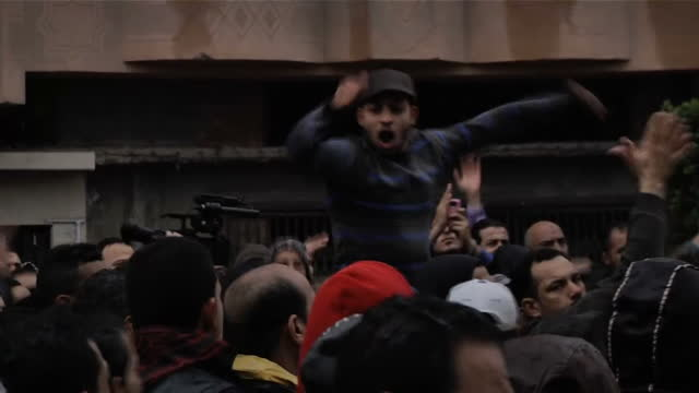 exterior shots crowd of protesters demonstrate to mark anniversary of football violence deaths recent sentencing of 21 people to death over riots... - port said stock videos & royalty-free footage