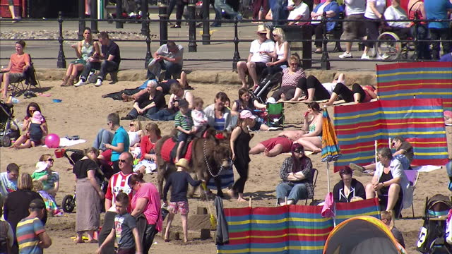 Exterior shots crowds of people on the beach enjoying the good weather in Scarborough UK Enjoys Warmest May Bank Holiday in Years on May 06 2013 in...