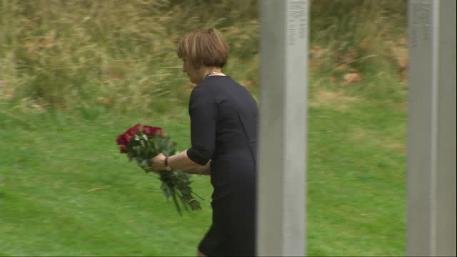 exterior shots dame tessa jowell laying flowers by the memorial plaque at the 7 july memorial in hyde park and bows her head in respect before... - memorial plaque stock videos and b-roll footage