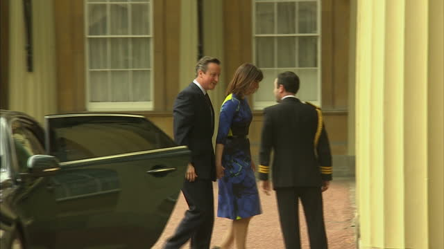 Exterior shots David Cameron and Samantha Cameron arrive at Buckingham Palace on May 08 2015 in London England