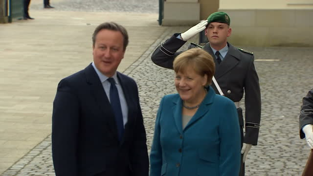 Exterior shots David Cameron British Prime Minister arrives at Schloss Herrenhausen palace and greets Angela Merkel German Chancellor ahead of G5...