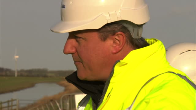 exterior shots david cameron british prime minister wearing hard hat high visibility jacket in croston to view clean up operation after severe... - david cameron politician stock videos & royalty-free footage