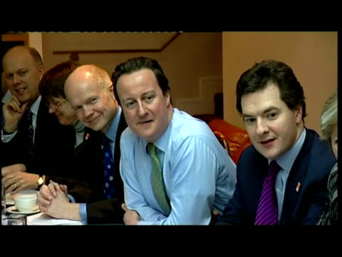 exterior shots david cameron poses with members of shadow cabinet local councillors in doorway of building interior shots david cameron sits with... - david cameron politician stock videos & royalty-free footage