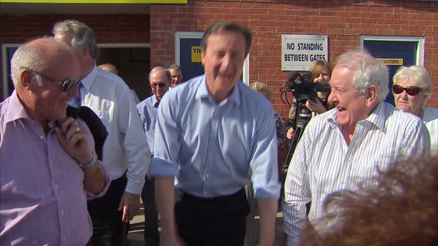 Exterior shots David Cameron Prime Minister and leader of Conservative Party meeting supporters outside Warrington Town FC ground on April 20 2015 in...