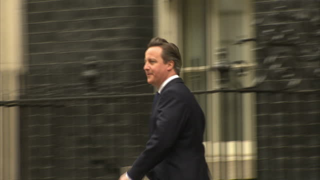 exterior shots david cameron prime minister gets into car outside downing street and heads for buckingham palace to inform the queen that he has... - david cameron politician stock videos & royalty-free footage