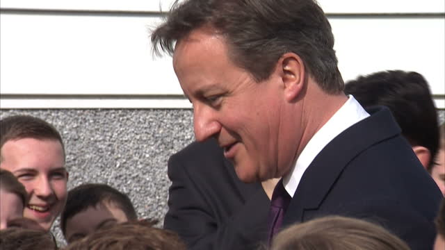 Exterior shots David Cameron Prime Minister talking to a large group of school children and asks whether he should use jujitsu on Nigel Farage UKIP...