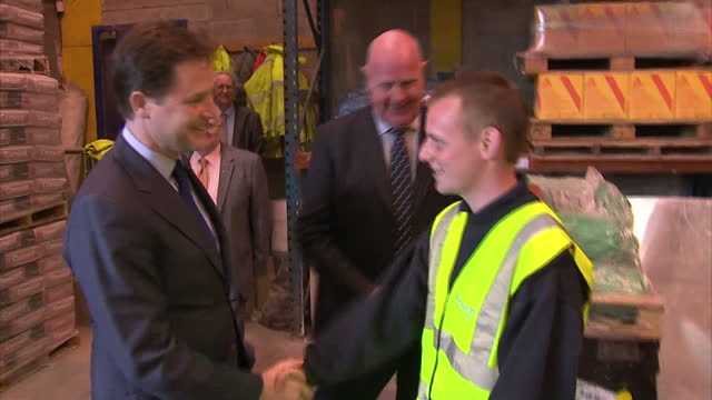exterior shots deputy prime minister arrives at benchmark building supplies is shown around by staff interior shots nick clegg tours the warehouse... - british liberal democratic party stock videos and b-roll footage