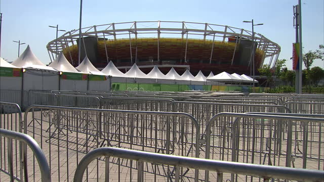 exterior shots deserted queue lines and checkpoints at the barra olympic park as it begins on empty after the final day of competition at the rio... - sport venue stock videos & royalty-free footage