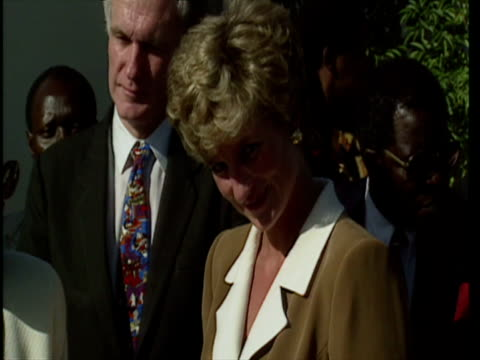 vídeos de stock e filmes b-roll de exterior shots diana princess of wales arrives and meets and greets residents at old people's home in zimbabwe princess diana visits oap home on july... - 1993