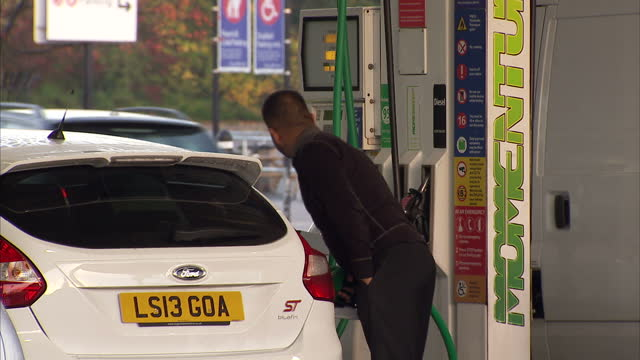 exterior shots drivers filling up their cars with petrol from tesco petrol station the cost on meter clearly visible in some shots supermarkets begin... - petrol stock videos & royalty-free footage