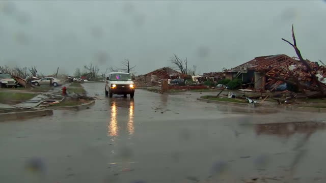 exterior shots driving past damaged homes debris caused by the f4 strength tornado which severely affected the town of moore driving past flattened... - oklahoma video stock e b–roll